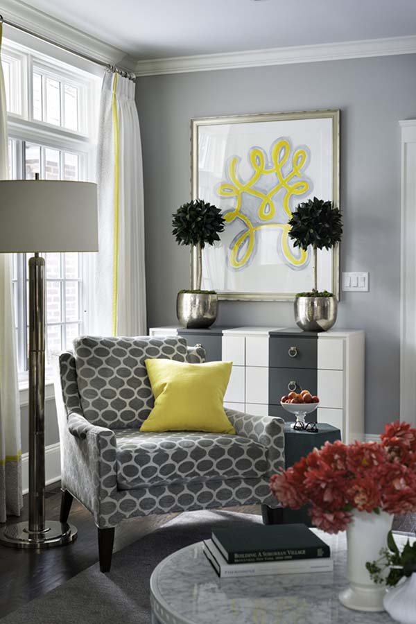 bright yellow pillow on grey chair